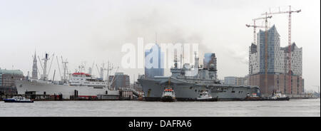 FILE - An archive picture dated 02 September 2011 shows the British helicopter carrier 'Illustrious' standing next - Stock Photo