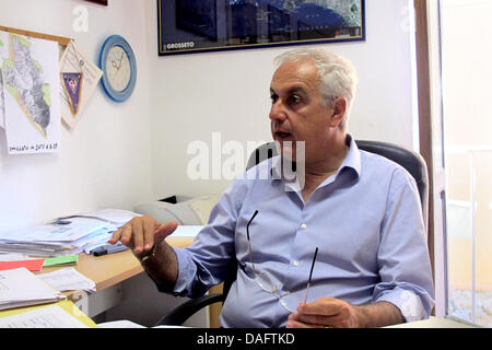Giglio, Italy. 10th July, 2013. Mayor of Giglio, Sergio Ortelli, sits in his office on the island of Giglio, Italy, - Stock Photo