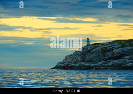 sunset at the Norwegian Sean coast with lighthouse, Norway, Lauvsnes - Stock Photo