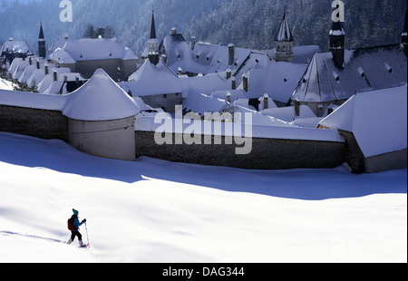 snowshoer at the snow-covered monastery 'La Grande Chartreuse', the head monastery of the Carthusian order, France, - Stock Photo
