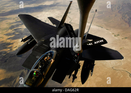 An F-15E Strike Eagle aircraft receives fuel from a KC-135R Stratotanker. Credit: U.S. Air Force - Stock Photo