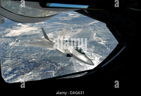 An F-22 Raptor viewed from a KC-135 Statotanker during a refueling operation. Credit U. S Air Force - Stock Photo