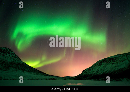 aurora gate in front of the starry sky over snow-covered valley, Norway, Troms, Kvaloea, Kattfjordeidet - Stock Photo