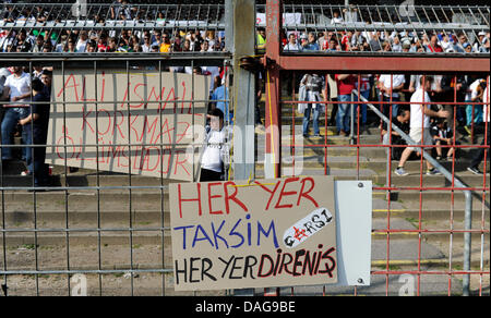 Istanbul fans have put up protest posters on the stadium fence before the test match between FC St.Pauli and Besiktas - Stock Photo