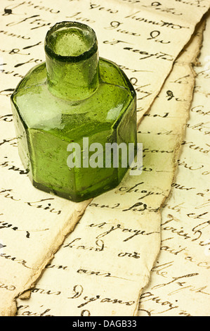 Inkwell on ancient manuscript - Stock Photo