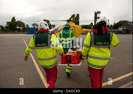 Paramedic Ambulance stretcher neck injury reconstruction - Stock Photo