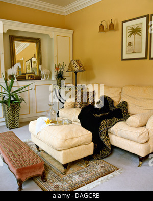 Cream Sofa And Ottoman Stool In A Townhouse Living Room