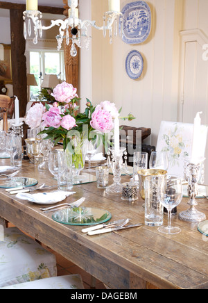 Vase Of Flowers On Antique Oak Table With Matching Chairs