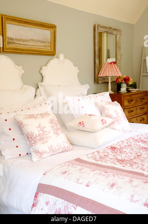 Toile de Jouy quilt on wrought iron bed in Spanish bedroom