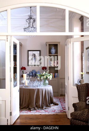 Open Half Glazed Double Doors With View Of Glassware On Circular Table Gray Cloth