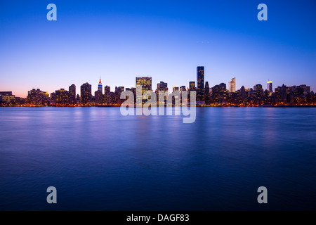 Midtown Manhattan skyline across the East River in New York City. - Stock Photo