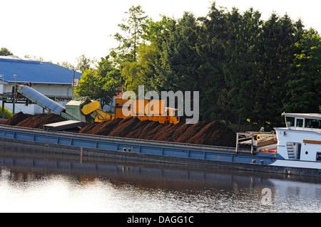 cargo ship loaded with peat in inner harbor of Bockhorst, Germany, Lower Saxony, Emsland, Bockhorst - Stock Photo