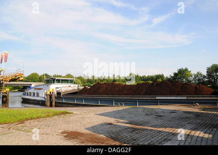 cargo ship loaded with peat in inner harbor of Bockhorst, Germany, Lower Saxony, Emsland, Bockhorst - Stock Photo