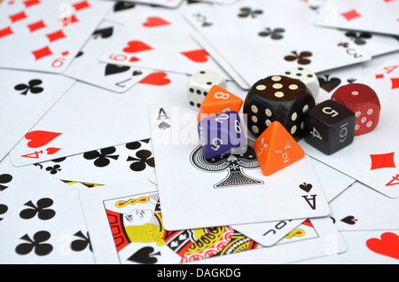 Poker cards with dices on top - Stock Photo