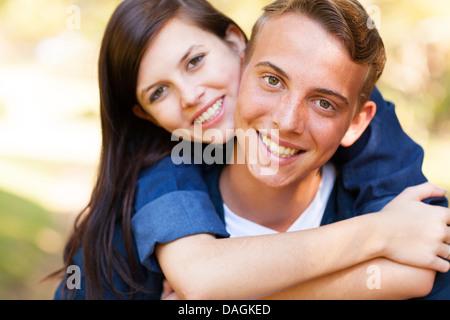 close up portrait of teenage couple enjoying summer day - Stock Photo