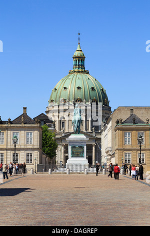 Amalienborg or Royal Palace courtyard with dome of Marble church (Frederik's Church) behind in Copenhagen Zealand - Stock Photo