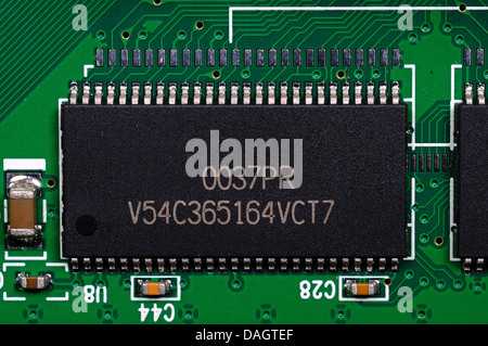 Micro processor chip attached to a printed circuit board. - Stock Photo