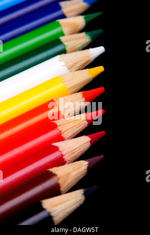 Color pencils isolated on black background - Stock Photo