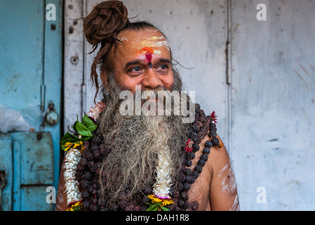 Sadhu, Hindu holy man, on a pilgrimage to the holy city of Varanasi, north India. - Stock Photo