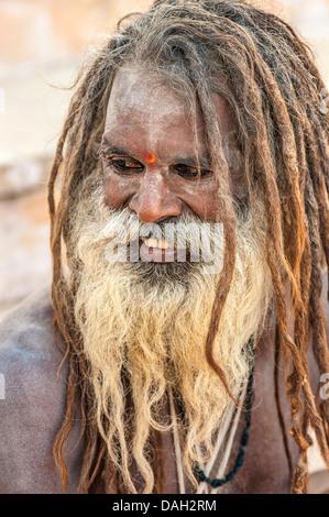 Sadhu, Hindu holy man, on a pilgrimage to the holy city of Pushkar, Rajasthan, India. - Stock Photo