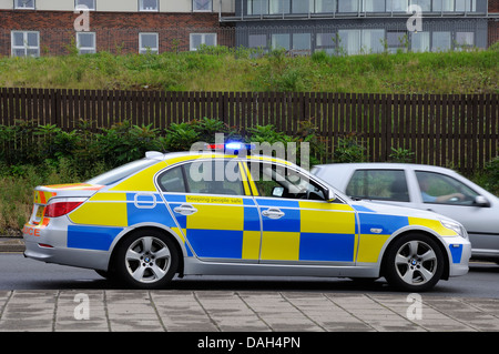 Police car with blue and yellow hi vis checkered livery - Stock Photo