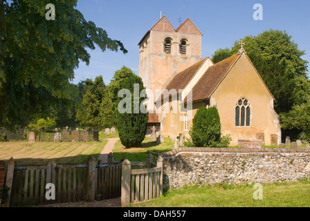 Bucks - Chiltern Hills - Fingest village - Norman church  St Bartholomew - framed by trees - flint boundary walls - Stock Photo