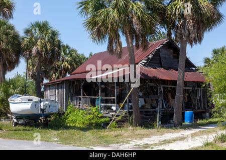 Cedar key florida old wood leaning stilt house famous for Wood frame house in florida