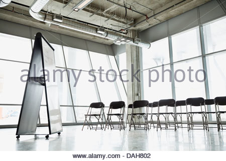 Interior of empty presentation room with chairs and white board - Stock Photo