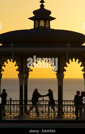 Dancing salsa on the Victorian bandstand, Brighton, Engand - Stock Photo