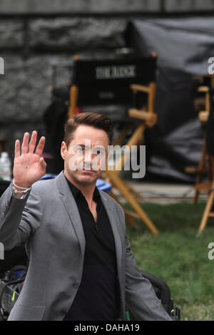 Dedham, Massachusetts. Robert Downey Jr waving at fans on the set of 'The Judge' in Dedham, Massachusetts, on July - Stock Photo