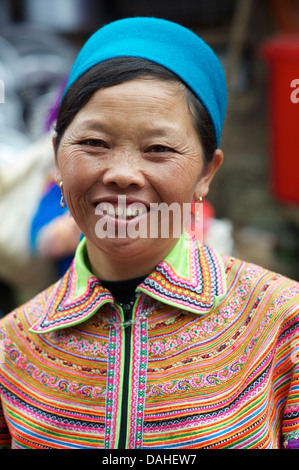 Potrait of a Flower Hmong woman in her brightly embroidered tribal costume, Can Cau, N Vietnam - Stock Photo