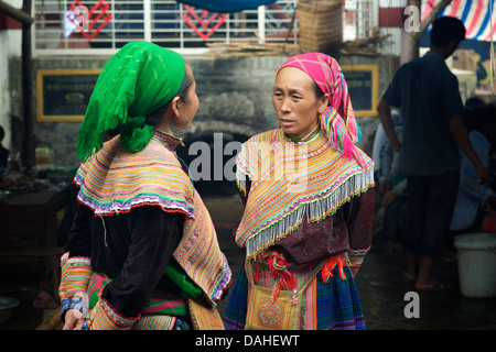 Flower Hmong women at Coc Ly market, near Bac Ha, Vietnam - Stock Photo