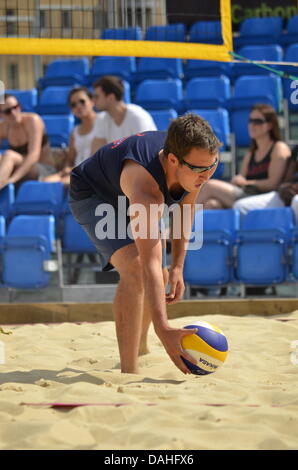 London, UK. 13th July, 2013. Beach Volleyball Championships 2013 in the Canary Wharf - Action For Kids Credit:  - Stock Photo