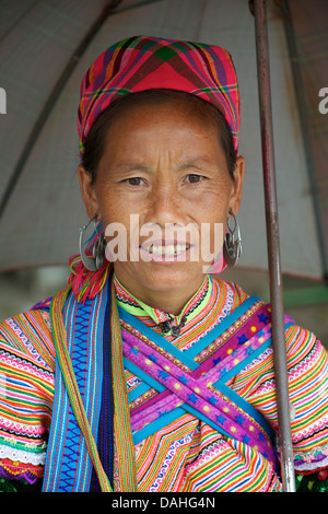 Potrait of a Flower Hmong woman in her brightly embroidered tribal costume, Bac Ha market, N Vietnam. Model Released - Stock Photo