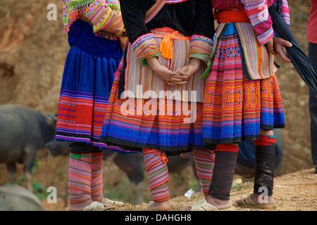 Detail of Flower Hmong woman's distinctive tribal costume.  Coc Ly market, N Vietnam - Stock Photo