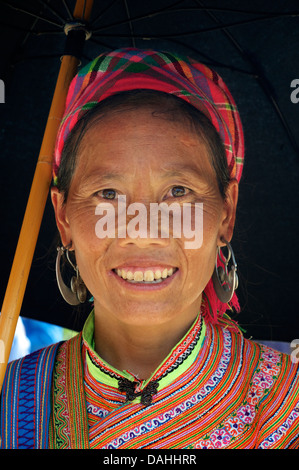 Potrait of a Flower Hmong woman in her brightly embroidered tribal costume, Coc Ly market, N Vietnam - Stock Photo