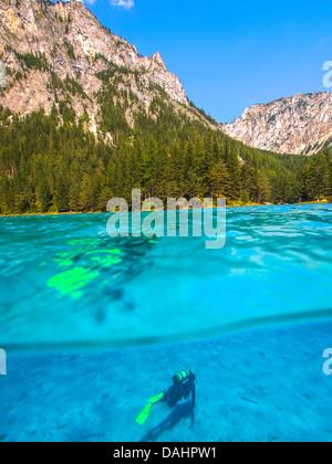 Altitude diving in mountain lake. Gruenner Sea, Alps - Stock Photo