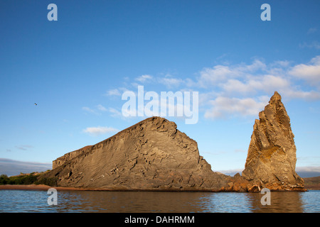 Pinnacle Rock on Bartolome Island, the remnant of an eroded volcanic tuff cone - Stock Photo