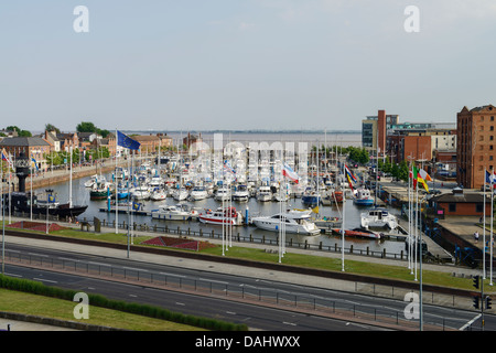 Boats in Hull marina with the River Humber in the distance - Stock Photo