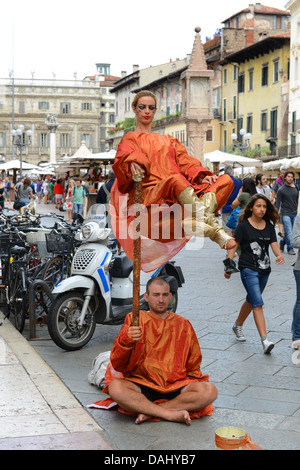 Man and woman street mime artists in Verona Italy - Stock Photo