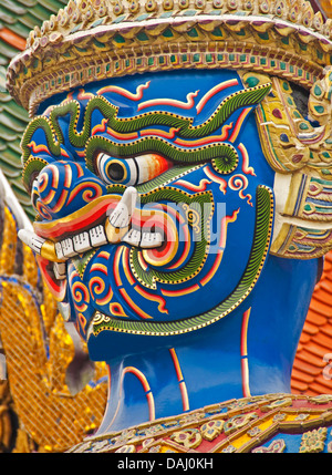 Face of giant demon (yaksha) statue guarding Wat Phra Kaew in Grand Palace in Bangkok. - Stock Photo