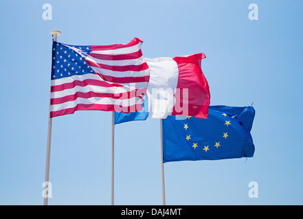 National flags of USA, and France with  the EEC flag, flying above the promenade in Nice, France - Stock Photo
