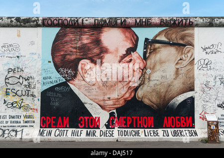 Fraternal Kiss (My God, Help Me to Survive This Deadly Love)  by Dimitri Vrubel, East Side Gallery, Berlin Wall, - Stock Photo