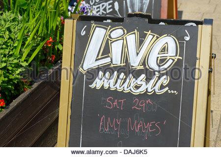 Pub blackboard advertising live music, Dorchester, Dorset England UK - Stock Photo