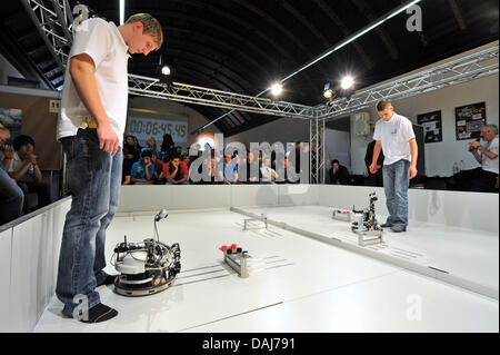 Finalists of 'Mobile Robotics 'prepare their machines in Erfurt, Germany, 22 March 2011. Twelve teams enter the - Stock Photo