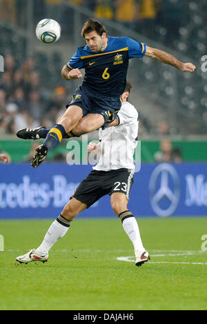 Germany's Mario Gomez (R) vies for the ball with Austrialia's Sasa Ognenovski during the international friendly - Stock Photo