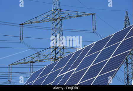 Power poles and solar cells are pictured in Bad Wildungen, Germany, 24 March 2011. Hessian Prime Minister Volker - Stock Photo