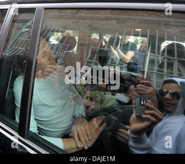 TV weather presenter Joerg Kachelmann sits in his lawyer's car after his release from prison in Mannheim, Germany, - Stock Photo