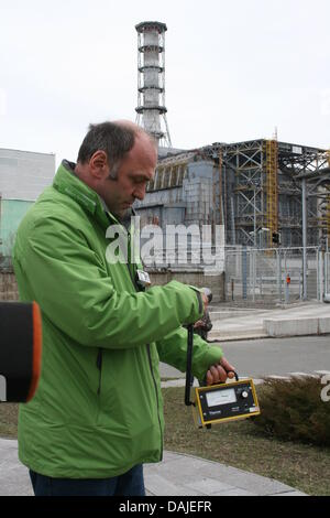 Greenpeace nuclear expert Heinz Smital stands in front of the destroyed accident reacter 4 at the nuclear power - Stock Photo