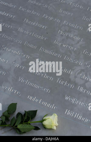 Flowers are laid in remembrance of the victims of the crimes of national socialism on the grounds of the former - Stock Photo